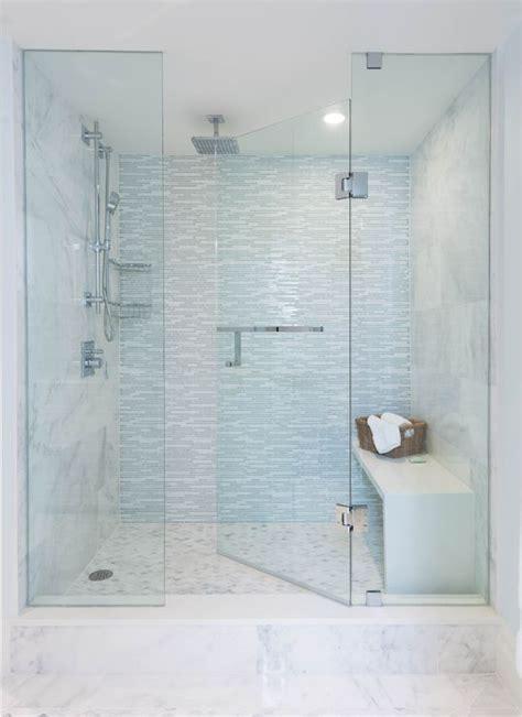 Seamless Glass Doors Large Walk In Shower Features A Seamless Glass Door Framing A Large Marble
