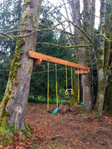 hanging a swing between two trees the tuscan home tree swings