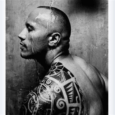 dwayne johnson tattoo artist dwayne johnson the rock the tattooing on his left arm