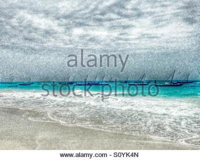 fishing boats in indian ocean tanzania zanzibar archipelago beach in the chwaka bay