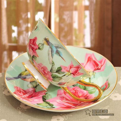 Porcelain tea cup and saucer ultra thin bone china flowers and birds pattern design outline in