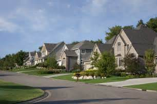 u home houses on upscale suburban in morning sunlight