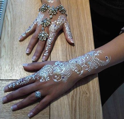 white henna tattoo on hand white henna beautiful we it henna