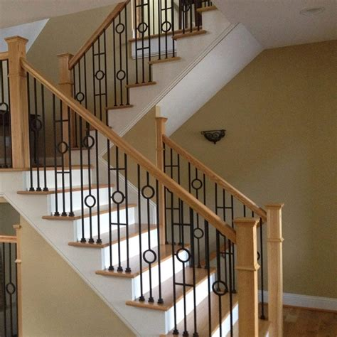rod iron banister choosing wood or wrought iron balusters for your home