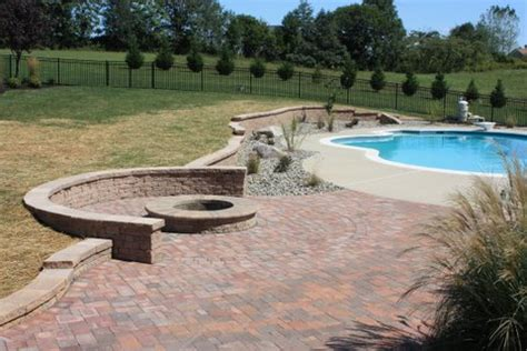Custom Outdoor Kitchen Designs by Firepit Near Swimming Pool Installed In Maryland