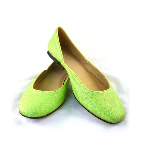 neon green woven raffia flats with leather trim and soles
