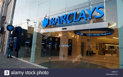 barclays banc exterior view of new barclays bank branch person getting