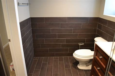 tile walls in bathroom floor tile extends to wall bathrooms pinterest in