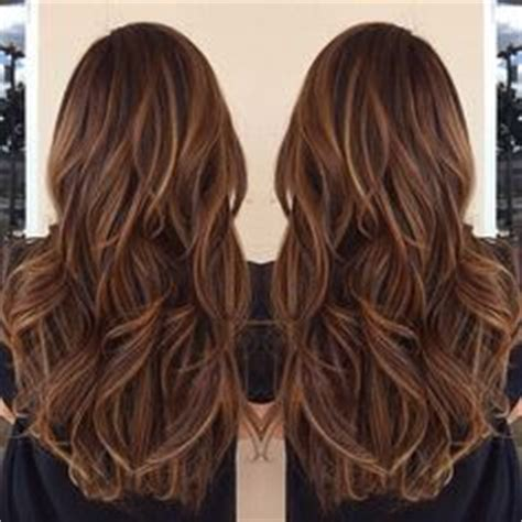 show me long curlylayers hai tri color dimensional hair highlights blonde and light