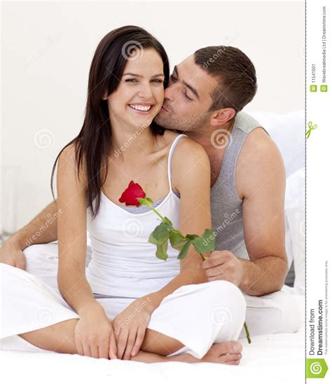cama holdings man kissing a woman and holding a rose stock image image
