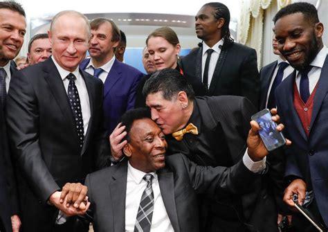 kanu nwankwo okocha president vladimir putin pose with football legends sports nigeria