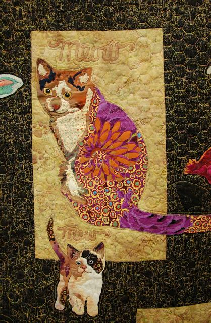 Patchwork Cats - pine needle quilt shop hanging by a thread quilt show