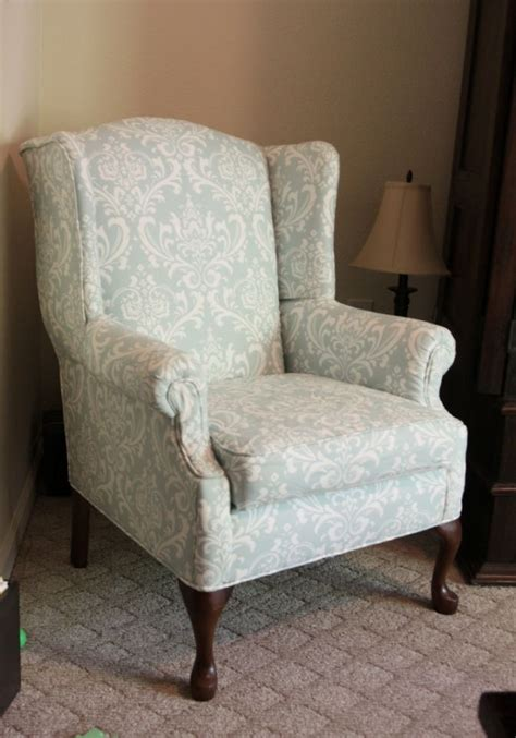 fabrics for chairs reupholstered wingback chair pretty damask fabric via