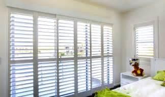 Plantation shutters for sliding windows