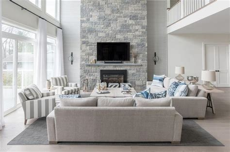 living rom blue and gray living room with a two story fireplace