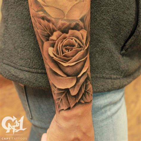 rose tattoo with leaves realistic rosebud and free flowing leaves by capone
