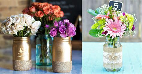 floreros con frascos de vidrio frascos de vidrio reciclados proyectos que intentar