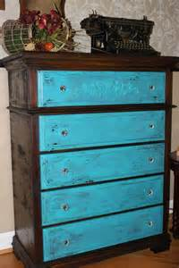 refinished 5 drawer dresser stained with painted drawers