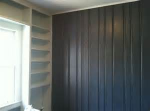 painted dark wood paneling grey and white shelving turned