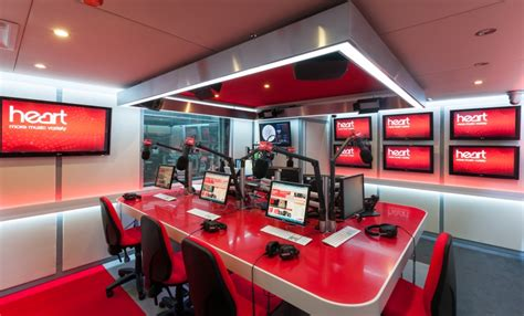 fm music station desking at heart radio station studio in hot red corian