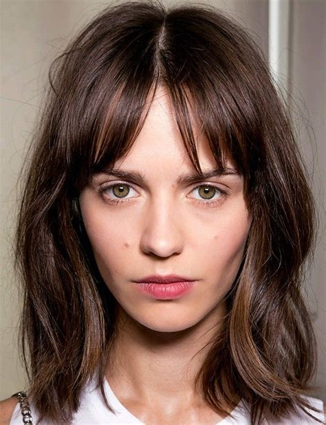 middle fringe hairstyle 12 hairstyles that will make you want bangs again fringe