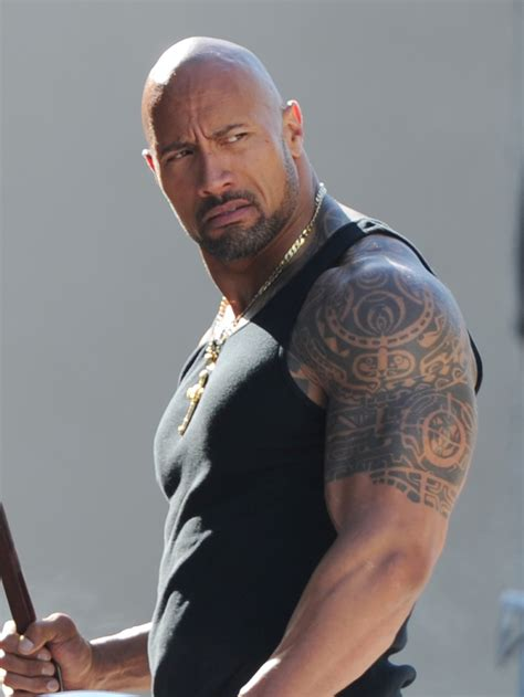 dwayne johnson getting tattoo 10 celebrity tattoos that ll make you want to get inked