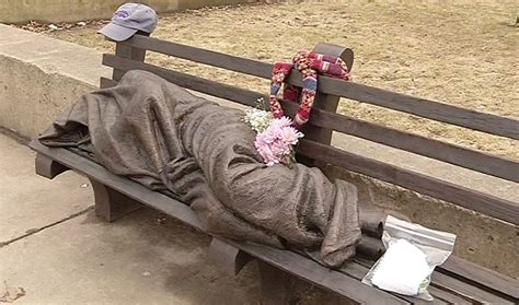 homeless jesus on park bench gifts being left at homeless jesus statue at buffalo