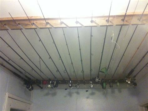 my made these ceiling mount fishing rod racks for me