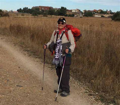 lonely planet camino de santiago lonely pilgrim with backpack walking the camino de