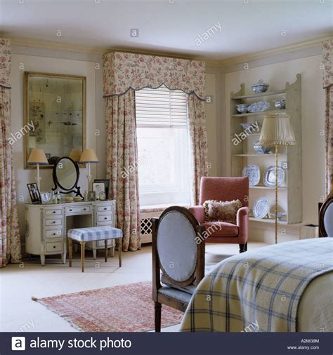 country house curtains bedroom with patterned curtains and dressing table in
