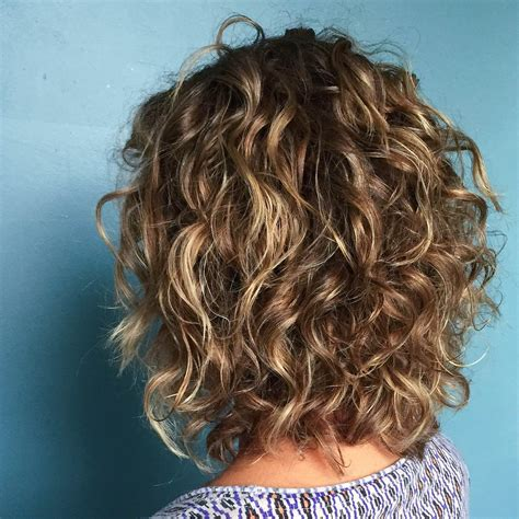 shoulder length layered natural curly haircuts with front and back pictures aveda stylist melody added a few highlights to give these
