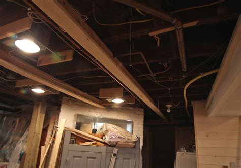remove drop ceiling attach t boards to beams above cut sections of beadboard and install like
