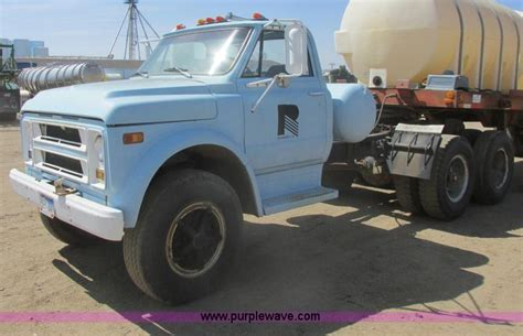 chevy semi truck ag equipment auction colorado auctioneers association