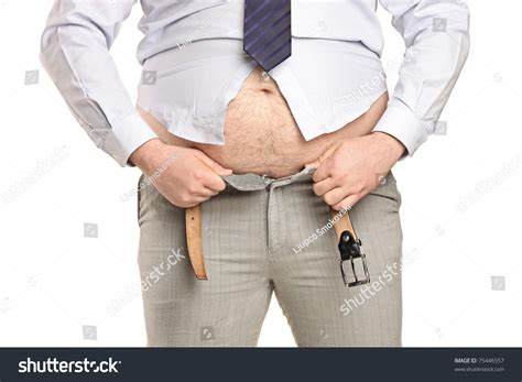 overweight trying fasten small clothes stock photo