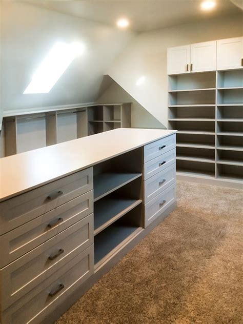 Walk In Closet With Center Island by Bonus Room Closet Ideas For Angled Ceilings