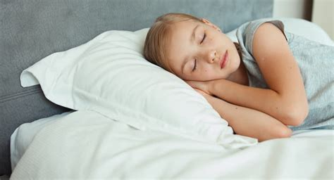 how to turn her on in bed beautiful girl sleeping in bed smiling in her sleep and