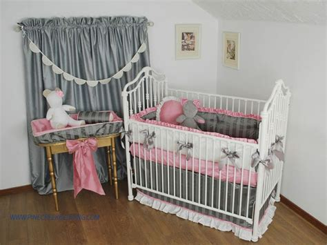 grey and pink tufted crib bumper with white silk and pink