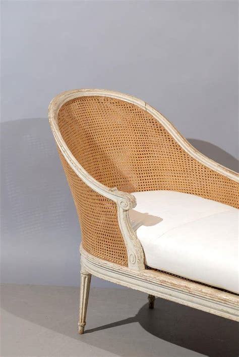 cane chaise louis xvi style painted and cane chaise lounge with loose