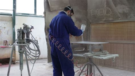 industrial spray painter employment painter in a factory industrial painting with airbrush