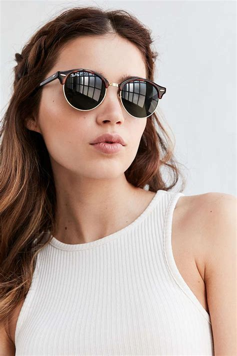woman wearing ray ban sunglasses ray ban clubround sunglasses urban outfitters ray ban