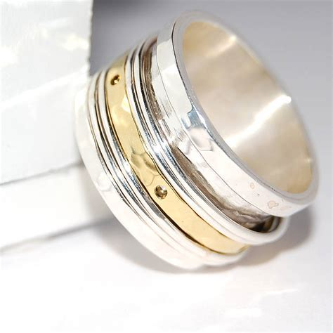 silver and gold spinning band ring by otis jaxon silver