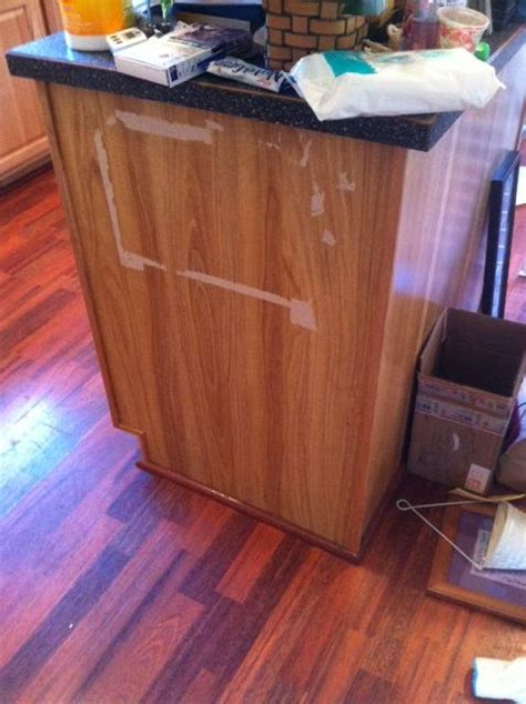 fixing kitchen cabinets how do i repair laminate damage on a kitchen cabinet