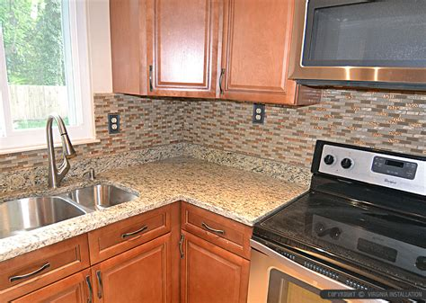 Granite Countertops With Glass Tile Backsplash by Brown Glass Backsplash Tile Santa Cecilia Countertops