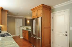 Enclosed refrigerator with door style panels traditional kitchen
