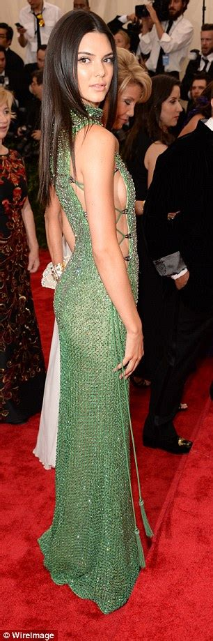 kendall jenner dons revealing dress at met gala as new face of calvin