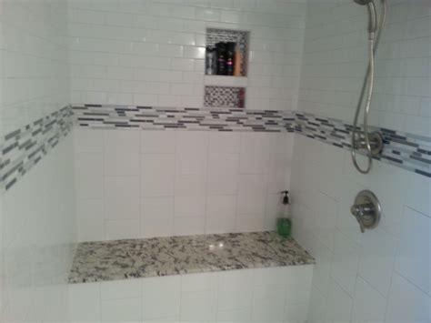 Ice blue granite vanity with matching granite shower seat custom shower