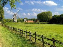shih tzu cloudy blue authentic windmill stock image image of windmill 15402817