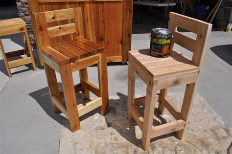 diy outdoor bar stools how to make super simple bar stools out of four 2x4 s