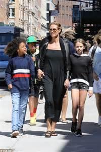 Maxi Leni heidi klum dons strapless black maxi dress as she takes