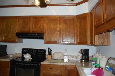 what to put above my kitchen cabinets should i put molding above my kitchen cabinets